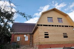 Двухэтажная пристройка к одоэтажному дому